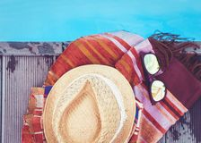 Vintage summer wicker straw beach hat, sun glasses, cover-up beachwear wrap near swimming pool, tropical background stock image