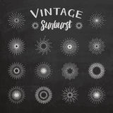 Vintage sunburst on chalkboard background Stock Images