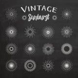 Vintage sunburst on chalkboard background Stock Images