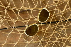 Vintage sunglasses and beam trawl. Vintage summer Stock Photography