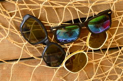 Vintage sunglasses and beam trawl. Vintage summer Royalty Free Stock Photo