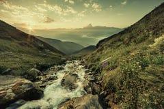 Vintage Sunrise over Highlands Stream royalty free stock photography
