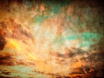 Vintage sunset sky background with paper texture. Vintage sunset sky and clouds background with paper texture royalty free illustration