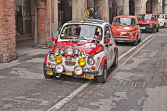 Vintage super equipped Fiat 500 F (1965). Driver on a vintage super equipped car Fiat 500 F (1965) in classic cars rally during the feast Sagra dei sapori d' royalty free stock photos