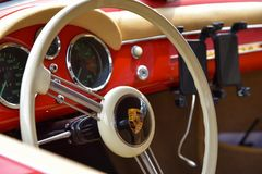Vintage supercar interior. MONZA, ITALY - MAY 19 : classic car interior with close-up on steering wheel. Car in old racing car in rally `Mille Miglia` 2018 the Stock Photo