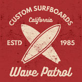 Vintage Surfing tee design. Retro t-shirt Graphics and Emblems for web design or print. Surfer, beach style logo design Royalty Free Stock Photos