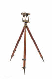 Vintage Surveyor's Level (Transit, Theodolite) on a Wooden Tripod isolated on White. Royalty Free Stock Photography