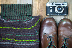 Vintage sweater, shoes, antique rangefinder camera Royalty Free Stock Images
