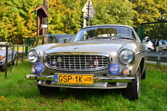 Classic Swedish car Volvo 1800 at a car show. Beautiful old Swedish Volvo P1800 at a car show with special Polish yellow number plates for ancient collectible royalty free stock images
