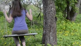 Vintage swing in garden stock footage