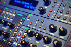 Vintage Synth in a studio rack. Blue Vintage Synthesizer in a studio rack royalty free stock image