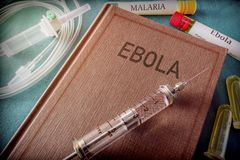 Vintage Syringe On A Book Of Ebola stock photography