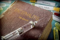 Vintage Syringe On A Book Of encephalitis Stock Image