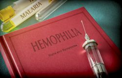 Vintage Syringe On A Book Of Hemophilia. Medical Concept Royalty Free Stock Photo