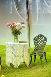 Vintage table with chairs in garden Royalty Free Stock Photography