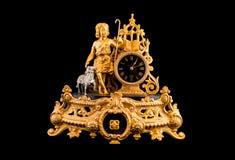 Vintage table clock on black background. Vintage bronze table clock on black background Stock Photo