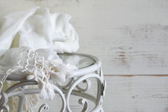 Vintage table with delicate scarf. selective focus. Royalty Free Stock Photo
