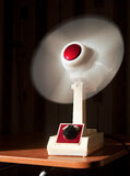 Vintage table fan. A vintage electric fan standing on a table Royalty Free Stock Images