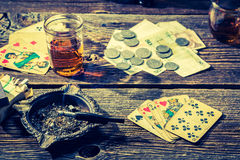 Vintage table for illegal poker with cards and money Stock Photography