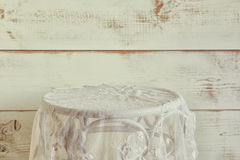 Vintage table with lace table cloth. product display. selective focus. vintage filtered Royalty Free Stock Photos