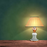 Vintage table lamp on green background Royalty Free Stock Images