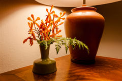 Vintage table lamp  light on wooden table with flowers Stock Images
