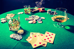 Vintage table for poker with whiskey, cigar and cards Royalty Free Stock Images