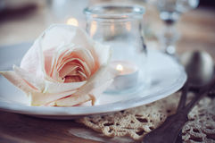 Vintage table setting with beige rose Royalty Free Stock Image