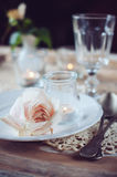 Vintage table setting with beige rose Stock Photos