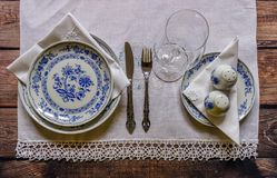 Vintage table setting with china and silver cutlery on the woode Stock Image