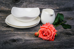 Vintage table setting with  dishes, milk jug and rose Stock Images