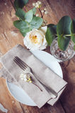 Vintage table setting with floral decorations Stock Image
