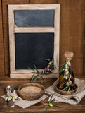 Vintage table setting with olives and  and antique blackboard on Stock Photos