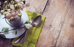 Vintage table setting with rose flowers Stock Photos