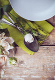 Vintage table setting with rose flowers Royalty Free Stock Photo