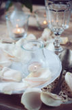 Vintage table setting with rose petals Stock Image