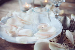 Vintage table setting with rose petals Stock Photos