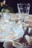 Vintage table setting with rose petals Stock Photography