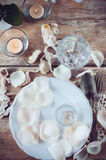 Vintage table setting with rose petals Royalty Free Stock Photography