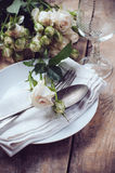 Vintage table setting with roses Royalty Free Stock Photo