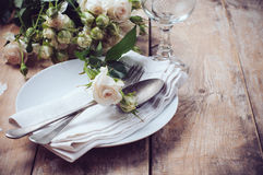 Vintage table setting with roses Royalty Free Stock Image