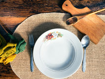 Vintage table setting with rustic dishes Royalty Free Stock Images