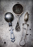 Vintage tableware on a metal old background. Royalty Free Stock Photo