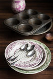 Vintage tableware set of plates, baking dish, muffin tin, spoons and cup Royalty Free Stock Photography