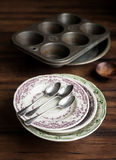 Vintage tableware set of plates, baking dish, muffin tin, spoons and cup Royalty Free Stock Images