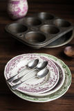 Vintage tableware set of plates, baking dish, muffin tin, spoons and cup Stock Images
