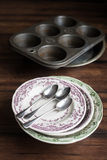 Vintage tableware set of plates, baking dish, muffin tin, spoons and cup Royalty Free Stock Image