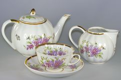 Vintage tableware. To drink tea and coffee with a beautiful set of tableware on gray Stock Images