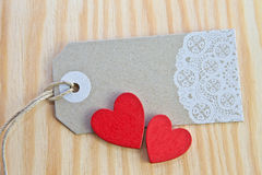 Vintage tag with red hearts Stock Photography