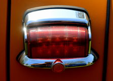 Vintage Tail Light on a Plymouth Coupe. Detail view of tail light on a vintage Plymouth coupe Royalty Free Stock Photo
